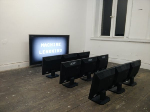 Photo of a computer teaching other computers